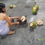 Chopping young coconuts