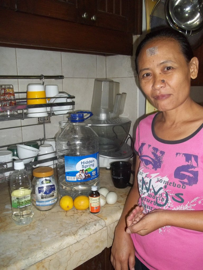 Gemma modeling some foods for healing: virgin coconut oil, black salt, lemons, duck eggs, castor oil, mineral water